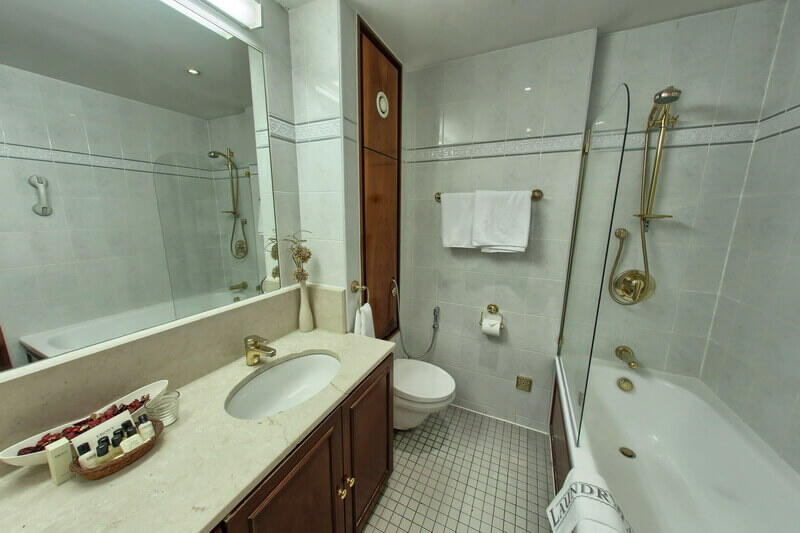 Single bathroom with bath and shower